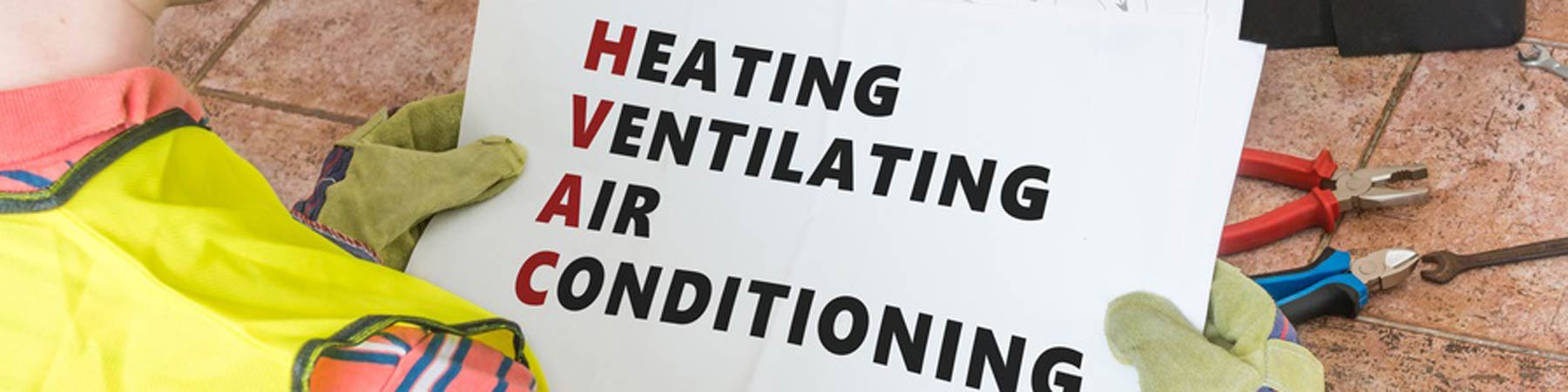 man holding hvac sign
