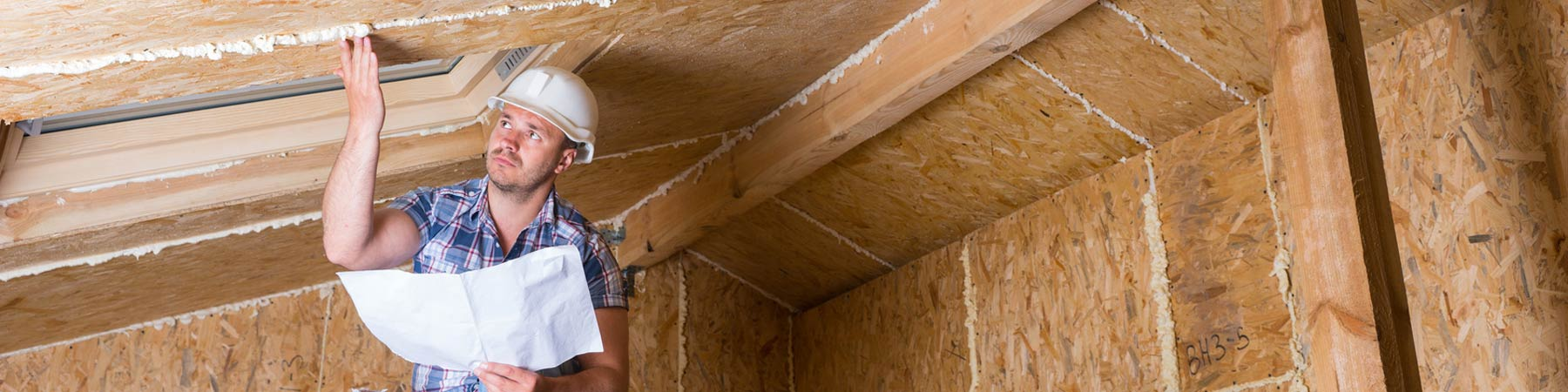 residential home inspector checking attic insulation