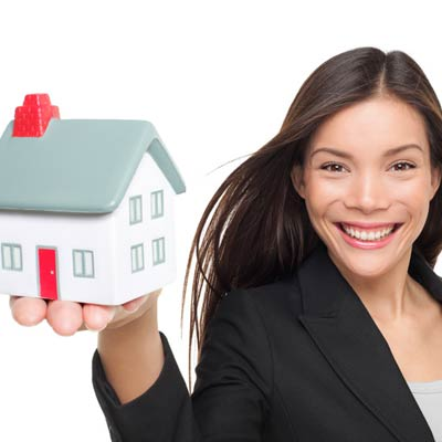 woman holding model home
